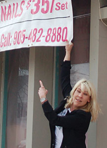 THE SIGN: Frances Stern of 2 Hot Blondes Hair Salon and a sign she says is being targeted by the city. (Philip Alves/Vaughan Today)